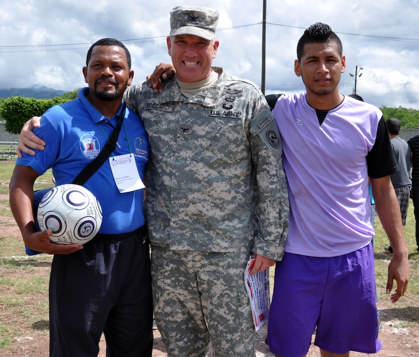 "U.S. Army Col. Thomas Boccardi, Joint Task Force-Bravo commander, presented soccer balls to participants of the Honduras Special Olympics soccer tournament at Soto Cano Air Base, Honduras, Oct. 25, 2013.  Boccardi presented the balls as part of ""Kick for Nick,"" a non-profit organization founded in honor of U.S. Army Pvt. Nick Madaras. While serving in Iraq in 2006, Madaras gathered soccer balls to give to underprivileged children near his post. However, he was killed and was never able to distribute the balls himself. Shortly after his death, the ""Kick for Nick"" organization was established in his honor. Today, soccer balls are donated and distributed to underprivileged children around the world through ""Kick for Nick,"" in memory of Pvt. Madaras. (U.S. Air Force photo by Capt. Zach Anderson)"