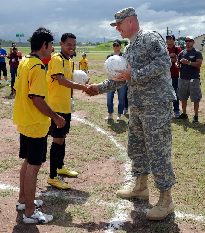 "U.S. Army Col. Thomas Boccardi, Joint Task Force-Bravo commander, presents soccer balls to participants of the Honduras Special Olympics soccer tournament at Soto Cano Air Base, Honduras, Oct. 25, 2013.  Boccardi presented the balls as part of ""Kick for Nick,"" a non-profit organization founded in honor of U.S. Army Pvt. Nick Madaras. While serving in Iraq in 2006, Madaras gathered soccer balls to give to underprivileged children near his post. However, he was killed and was never able to distribute the balls himself. Shortly after his death, the ""Kick for Nick"" organization was established in his honor. Today, soccer balls are donated and distributed to underprivileged children around the world through ""Kick for Nick,"" in memory of Pvt. Madaras. (Photo by Martin Chahin)"