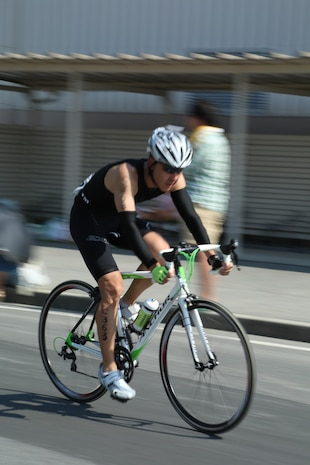 A participant pedals along the 28-kilometer bike course during the Japanese and American Goodwill Modified Triathlon aboard Marine Corps Air Station Iwakuni, Japan, Sept. 22, 2013. The gates of MCAS Iwakuni were open from 6 a.m. to 7 a.m. to allow Japanese civilians aboard station.