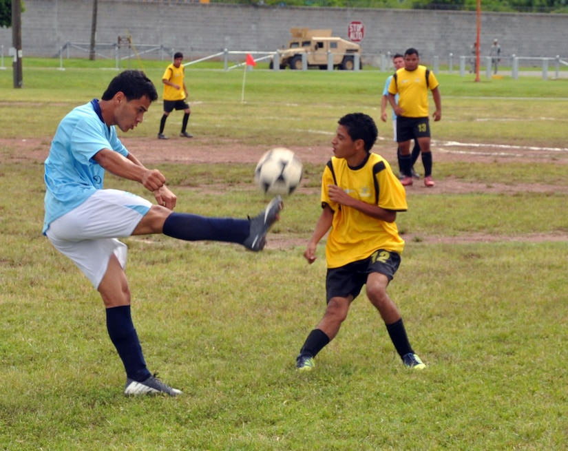Honduran Special Olympics athletes compete in a soccer match at Soto Cano Air Base, Honduras, Oct. 26, 2013.  Joint Task Force-Bravo partnered with Special Olympics-Honduras and the Honduran Air Force to host the Special Olympics soccer tournament.  (U.S. Air Force photo by Capt. Zach Anderson)