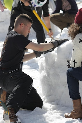 Combat Logistics Company 36 Marines place the roof on their igloo during the First World Igloo Building Championship competition, which took place at the Osorakan Snow Park, located in the town of Akiota, Feb. 3, 2013. Teams were limited to a maximum of six participants.