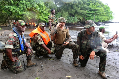 During an amphibious assault simulation with U.S. and Spanish Marine advisors to Cameroonian soldiers, Maj. Kyle Andrews, officer-in-charge of U.S. Marines assigned to Africa Partnership Station 13, observe the multi-lateral the final exercise with Cameroonian and Dutch counterparts. The military-to-military engagement in Limbe, Cameroon, from October 18-25 was the last stop on APS' three-month tour around the west coast of Africa aboard the HNLMS Rotterdam (L800), a Royal Netherlands Navy (RNLN) landing platform dock, that conducted training engagements with African nations to increase maritime security, partner-nation military capacity, and promote regional stability.