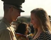 A new Marine of India Company, 3rd Recruit Training Battalion, greets his family following his graduation ceremony Oct. 25, 2013, on Parris Island, S.C. The Marines spent nearly 13 weeks away from home training to earn their places in the Corps. (Photo by Cpl. Caitlin Brink)