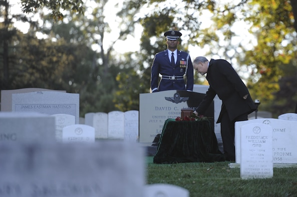 An attendee places a rose over retired Gen. David C. Jones burial site after his funeral Oct. 25, 2013, at Arlington National Cemetery, Va. Jones served four years as Air Force chief of staff from 1974 to 1978 until he was appointed as chairman of the Joint Chiefs of Staff. As chairman he served as the senior military adviser to the president, helping set in motion a sweeping reorganization of the nation's military command. Jones died Aug. 10, 2013 at the age of 92.