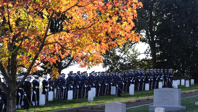 The United States Air Force and Navy Honor Guard Drill Team pay tribute to retired Gen. David C. Jones as he's laid to rest Oct. 25, 2013, at Arlington National Cemetery, Va. Jones served four years as Air Force chief of staff from 1974 to 1978 until he was appointed as chairman of the Joint Chiefs of Staff, June 21, 1978. As chairman he served as the senior military adviser to the president, the National Security Council and the secretary of Defense.  During the Korean War, Jones was assigned to a bombardment squadron where he accumulated more than 300 flight hours on missions over North Korea.