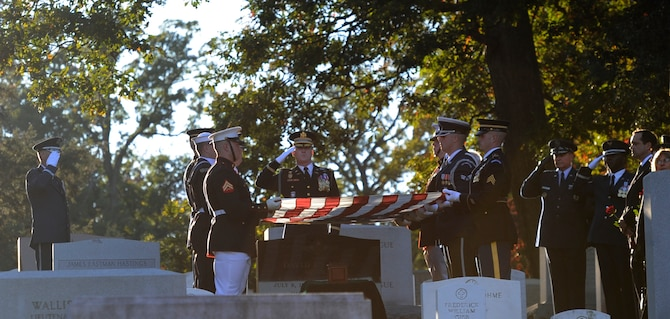 A joint service color guard folds the flag over retired Gen. David C. Jones' casket during his funeral Oct. 25, 2013, at Arlington National Cemetery, Va. Jones served four years as Air Force chief of staff from 1974 to 1978 until he was appointed chairman of the Joint Chiefs of Staff June 21, 1978. As chairman he served as the senior military adviser to the president, the National Security Council and the secretary of Defense. He entered the Army Air Corps and began aviation cadet training in April 1942. He received his commission and pilot wings in February 1943. The Army, Marine Corp and Coast Guard were also in attendance conducting military honors.