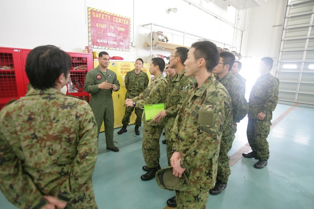 Gunnery Sgt. Nathan K. Lanham, an Aircraft Rescue Firefighting section leader, leads a tour for Japan Ground Self Defense Force soldiers of ARFF facilities here Feb. 28, 2013.