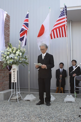 "Shimada Yoshikuni, a minister from the Onomichi Yoshiwa Dendosho branch of the United Church of Christ in Japan, recites a prayer during a memorial for POWs from Mukaishima POW Sub-Camp No. 4 in Onomichi, Japan, April 15, 2013. The location was once the sight of the camp. ""It is important for us to continue to remember the men and women from all nations who fought in the great conflict,"" said Col. James C. Stewart, Marine Corps Air Station Iwakuni commanding officer. ""This memorial will stand as a reminder of their tremendous sacrifice and our desire for world peace. Today, Japan and the United States and the United Kingdom form the strongest and most important security alliance in the world."""