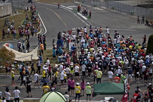 Participants in the 46th annual Kintai Marathon begin the full marathon portion of the race, which started in front of the IronWorks Gym here, April 14, 2013. More than 1000 people participated in the marathon.