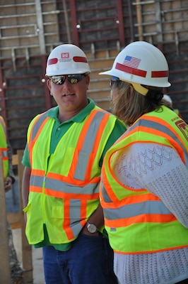 DEVILS LAKE, N.D. -- Mathew Andersen, left, engineering and construction, and Bonnie Greenleaf, project management,discuss the Devils Lake, N.D., project July 31.