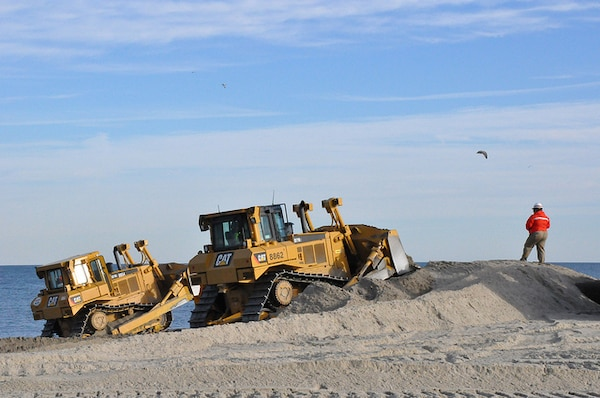 Sand being placed at Monmouth Beach, New Jersey, part of the beach renourishment project for coastal storm risk reduction that the U.S. Army Corps of Engineers is managing in partnership with the state of New Jersey.
