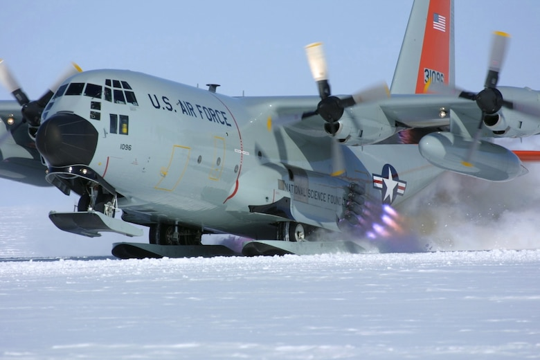 CAMP SUMMIT, Greenland -- Air National Guard aircrew members utilize a jet-assisted takeoff from Camp Summit in April 2003. The ski-equipped LC-130 Hercules is assigned to the New York Air National Guard's 109th Airlift Wing. JATO provides a few extra knots of speed to pull the aircraft's nose up from skiways on the Greenland ice sheet. (Courtesy photo by Dr. Todd Valentic)