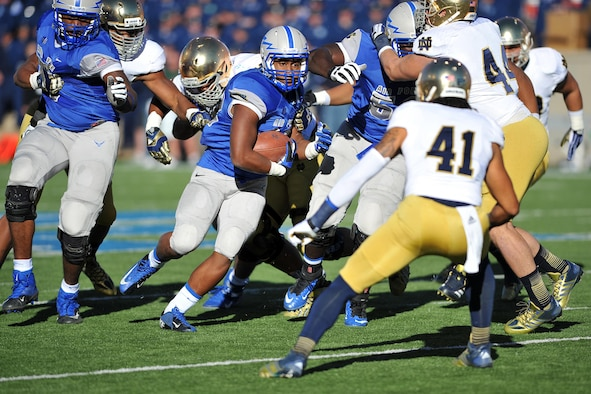 Air Force junior running back Broam Hart rushes the ball for 9 yards during the second quarter of the Air Force-Notre Dame Oct. 26, 2013, at Falcon Stadium in Colorado Springs, Colo. The Falcons fell to the Fighting Irish, 45-10. (U.S. Air Force photo/Sam Lee)