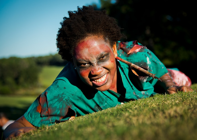 A zombie nurse crawls forward at the 2nd Annual Zombie Run Oct. 26 at the Eglin Air Force Base golf course.  More than 500 people attempted to outrun zombies and maneuver through various obstacles along the four-mile course.  (U.S. Air Force photo/Samuel King Jr.)