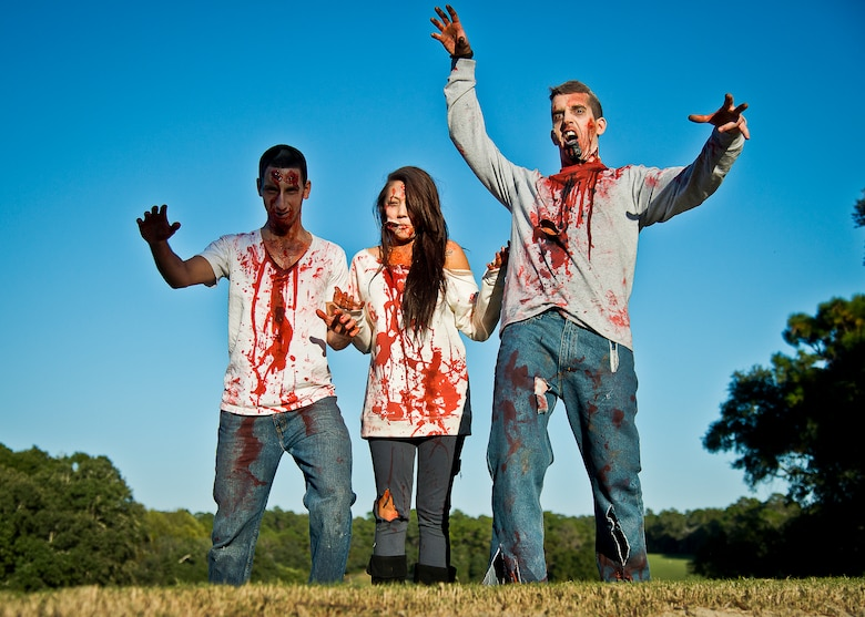 Bloody zombies move toward the runners at the 2nd Annual Zombie Run Oct. 26 at the Eglin Air Force Base golf course.  More than 500 people attempted to outrun zombies and maneuver through various obstacles along the four-mile course.  (U.S. Air Force photo/Samuel King Jr.)