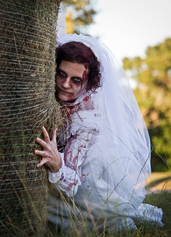 A zombie bride waits for the next group of runners during the 2nd Annual Zombie Run Oct. 26 at the Eglin Air Force Base golf course.  More than 500 people attempted to outrun zombies and maneuver through various obstacles along the four-mile course.  (U.S. Air Force photo/Samuel King Jr.)