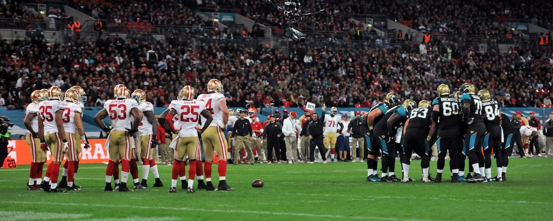 The National Football League's Jacksonville Jaguars played the San Francisco 49ers in an internationally televised game Oct. 27, 2013, at Wembley Stadium in London, England. The NFL gave U.S. Air Force Airman 1st Class James Taylor, 100th Security Forces Squadron patrolman, and U.S. Air Force Airman Sara V. Summers, 48th Security Forces Squadron patrolman from RAF Lakenheath, the opportunity to lead rival football teams onto the field. The Jacksonville Jaguars lost the game against the San Francisco 49ers 42-10. (U.S. Air Force photo by Senior Airman Christine Griffiths/Released)