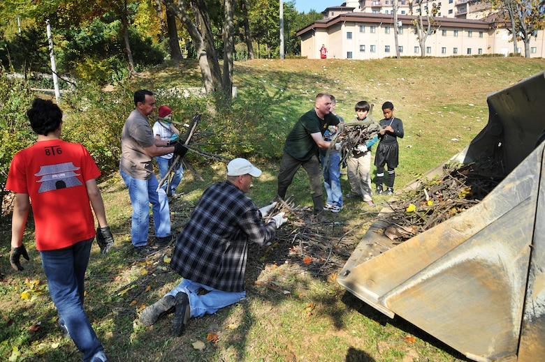 Volunteers clean up the Mustang Valley Park at Osan Air Base, Republic of Korea, Oct. 26, 2013. In order to maintain the park's cleanliness, the groups plan on seasonal cleaning when the leaves fall and at the beginning of spring. (U.S. Air Force photo/Staff Sgt. Emerson Nuñez)