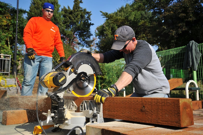 Tech. Sgt. Justin McGovern, 51st Civil Engineer Squadron structural craftsman, makes new steps for the Mustang Valley Park at Osan Air Base, Republic of Korea, Oct. 26, 2013. The 51st CES provided all the tools and equipment for volunteers to use during the clean-up. (U.S. Air Force photo/Staff Sgt. Emerson Nuñez)