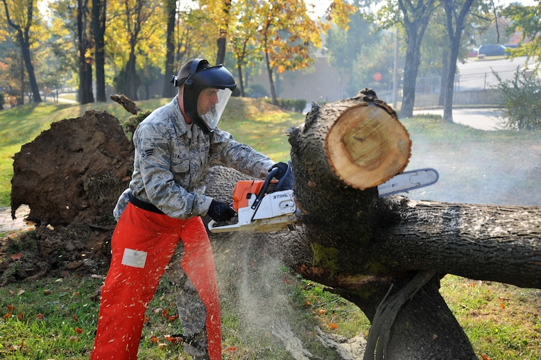 Senior Airman Tres Stallard, 51st Civil Engineer Squadron heavy equipment operator, takes apart a tree limb at Mustang Valley Park at Osan Air Base, Republic of Korea, Oct. 26, 2013. In order to maintain the park's cleanliness, the groups plan on seasonal cleaning when the leaves fall and at the beginning of spring. (U.S. Air Force photo/Staff Sgt. Emerson Nuñez)