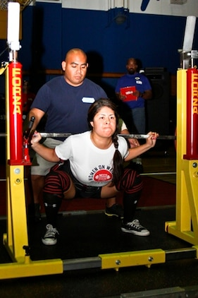 Nancy Rodriguez, the 148-pound female division second place winner, squats 176 pounds during the Far East Powerlifting Championship Competition at the IronWorks Gym sports courts here Aug. 12, 2012. Rodriguez lifted a total combined weight of 491 pounds in the squat, bench press and deadlift events.