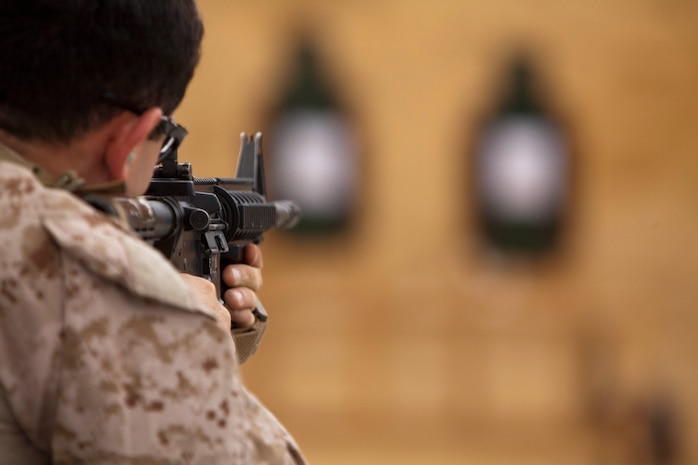 """A corpsman with Battalion Landing Team 2nd Battalion, 4th Marines, 31st Marine Expeditionary Unit, fires at his target during a marksmanship qualification event as a part of the battalion's Corpsman Cup here, Oct. 22. The competition included all """"docs"""" within the battalion and tested medical skills used during combat, in garrison and on ship. The competition served a dual purpose in honing the sailors' skills under pressure and providing a fun bonding experience. The 31st MEU is the Marine Corps force in readiness for the Asia-Pacific region and is the only continuously forward-deployed MEU."""