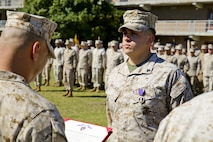 MARINE CORPS BASE CAMP LEJEUNE, N.C. – Cpl. Richard Wallace, a team leader with Fox Company, 2nd Battalion, 2nd Marine Regiment and Chicago native, receives his Purple Heart Medal for wounds received in Afghanistan in support of Operation Enduring Freedom Oct. 24, 2013.  (Official U.S. Marine Corps photo by Lance Cpl. Michael C. Dye)