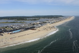 Aerial image from September 7, 2013 shows a completed portion of a beach in Sea Bright New Jersey as restoration work continues. The Corps is placing roughly 8 million cubic yards of sand from Sea Bright to Manasquan Inlet to replace sand lost during Hurricane Sandy and restore the project area to its original design. This is being done to restore the previously built risk reduction beach project and help reduce coastal storm risks to the community in the future.