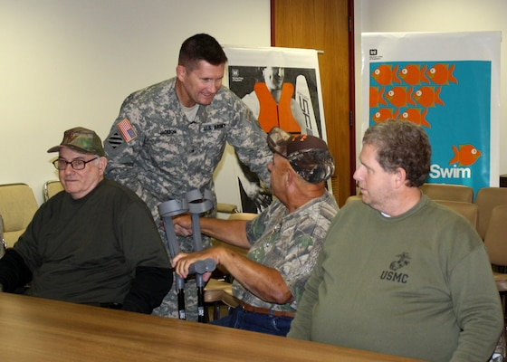 USACE South Atlantic Division Commander Brig. Gen. Donald E. (Ed) Jackson shakes hands with members of the Paralyzed Veterans of America Southeastern chapter at Richard B. Russell Lake, Oct. 23, 2013.
