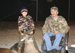 Ricky Pless, a member of the Paralyzed Veterans of America Southeast chapeter, and his grandson Landon pose with a deer harvested at the U.S. Army Corps of Engineers Richard B. Russell Lake, Oct. 23, 2013.