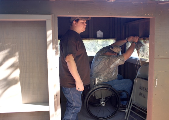 PVA member Tommy and his son Max get ready to hunt from a wheelchair accessible hunting blind at the U.S. Army Corps of Engineers Richard B. Russell Lake.