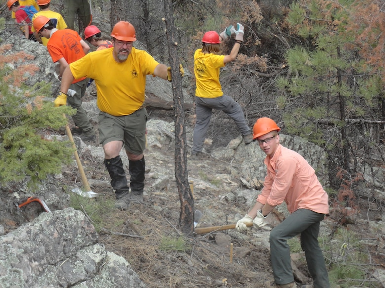 David Quebedeaux has built miles of trails as part of his job with the U.S. Army Corps of Engineers and in his volunteer position with the Boy Scouts. While at the Philmont Scout Ranch this summer, Quebedeaux (left) and Eagle Scout Marshall Knox (right) and the rest of the crew helped lay out and begin construction on a new section of trail near the Cimarron River, shown here June 14, 2013. Courtesy photo.