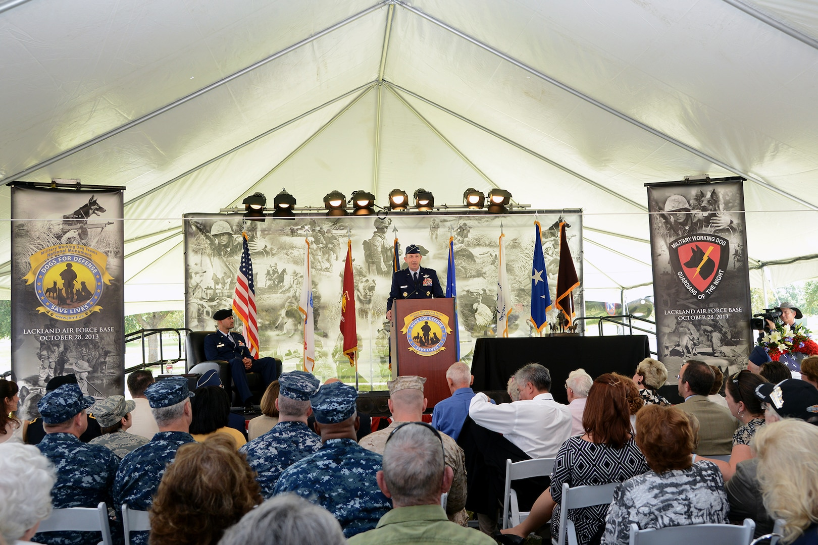 JOINT BASE SAN ANTONIO-LACKLAND, Texas --Lt. Gen. James Holmes Vice Commander, Air Education and Training Command, Joint Base San Antonio-Randolph, speaks at the U.S. Military Working Dog Teams National Monument dedication ceremony Oct. 28 at Joint Base San Antonio-Lackland. JBSA-Lackland is the home to the Department of Defense Military Working Dog Program and is where the U.S. Armed Forces has been training its military working dog teams since 1958. It is the world's largest training center for military dogs and handlers and is also home to the largest veterinary hospital for military working dogs.(U.S. Air Force photo by Ben Faske)