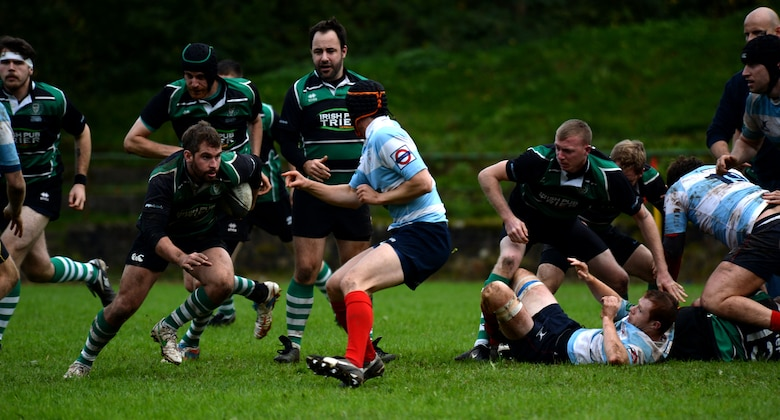 SPANGDAHLEM AIR BASE, Germany--Elliot Curtis, a 52nd Force Support Squadron Eifel Arms Inn shuttle driver from Fort Walton Beach, Fla., runs during a rugby game at the University of Trier Rugby Pitch Oct. 12, 2013. The University of Trier Rugby team won the championship for the region liga three times out of the last five years. (U.S. Air Force photo by Senior Airman Rusty Frank/Released)