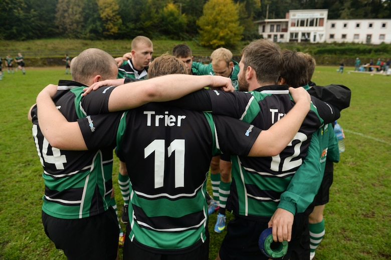 SPANGDAHLEM AIR BASE, Germany--Elliot Curtis, a 52nd Force Support Squadron Eifel Arms Inn shuttle driver from Fort Walton Beach, Fla., and his team mates huddle up before kickoff of a rugby game at the University of Trier Rugby Pitch Oct. 12, 2013. Curtis credits the comrade of rugby as one of the many things he loves about the game. (U.S. Air Force photo by Senior Airman Rusty Frank/Released)
