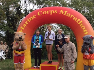 Armed Forces Runners take the overall Marine Corps Marathon top three positions:  1st- CPT Kelly Calway (Army)  Fort Carson, CO – 2:42:16; 2nd- LT Gina Slaby (Navy) JEB Virginia Beach, VA – 2:48:02; 3rd- SrA Emily Shertzer (USAF) Fort Indiantown Gap, PA – 2:48:08