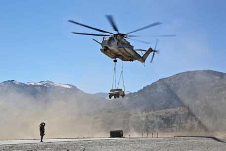 A CH-53E Super Stallion transports a HMMVW while Marines with Landing Support Company, Combat Logistics Regiment 17, 1st Marine Logistics Group, conducted helicopter support team training during Mountain Exercise 6-13, aboard Marine Corps Mountain Warfare Training Center in Bridgeport, Calif., Oct. 18, 2013. During the exercise, a small detachment of Marines from 1st MLG provided logistical support to 1st Battalion, 5th Marine Regiment, 1st Marine Division.