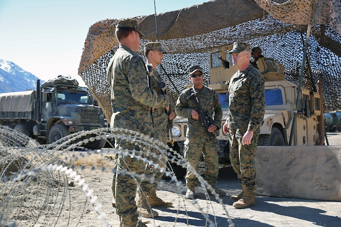 Brigadier Gen. Vincent A. Coglianese, right, commanding general, 1st Marine Logistics Group, speaks with Marines from Combat Logistics Battalion 5, Combat Logistics Regiment 1, 1st MLG, during Mountain Exercise 6-13, aboard Marine Corps Mountain Warfare Training Center in Bridgeport, Calif., Oct. 18, 2013. During the exercise, a small detachment of Marines from 1st MLG provided logistical support to 1st Battalion, 5th Marine Regiment, 1st Marine Division.