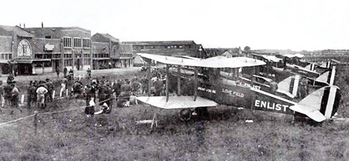 "A photograph from 1918 shows Curtiss JN-4 ""Jenny"" biplanes of the Army"