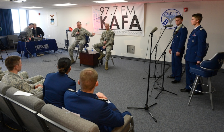 """Air Force Chief of Staff Gen. Mark A. Welsh III and Chief Master Sgt. of the Air Force James Cody answer questions during """"Stars and Chevrons,"""" a show on the U.S. Air Force Academy cadet-run radio station, KAFA 97.7 FM, Oct. 29, 2013, Colorado Springs, Colo.  Welsh and Cody answered questions from budget uncertainty to professional development during the hour-long show. (U.S. Air Force Photo/Scott Ash)"""
