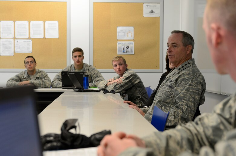 """Air Force Chief of Staff Gen. Mark A. Welsh III speaks with cadets during a Behavioral Science 310 class Oct. 28, 2013, U.S. Air Force Academy, Colorado Springs, Colo. Welsh, along with Chief Master Sgt. of the Air Force James Cody, visited with cadets Oct. 28 and 29. Welsh also hosted a cadet call, met with cadets over lunch and teamed with Cody to answer questions during """"Stars and Chevrons,"""" a show on the cadet-run radio station, KAFA 97.7 FM. (U.S. Air Force Photo/Scott Ash)"""