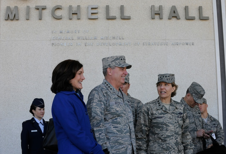 """Air Force Chief of Staff Gen. Mark A. Welsh III, his wife, Betty, and Lt. Gen. Michelle Johnson, U.S. Air Force Academy superintendent, stand outside Mitchell Hall to observe cadet formation Oct. 28, 2013, Colorado Springs, Colo. Welsh, along with Chief Master Sgt. of the Air Force James Cody, visited with cadets Oct. 28 and 29 prior to participating in Air Force senior leader meetings the remainder of the week.  In addition to hosting a cadet call, Welsh met with cadets over lunch and during several classroom visits and teamed with Cody to answer questions during """"Stars and Chevrons,"""" a show on the cadet-run radio station, KAFA 97.7 FM. (U.S. Air Force Photo/Scott Ash)"""