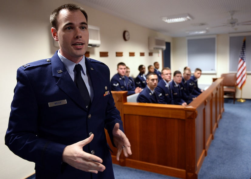"SPANGDAHLEM AIR BASE, Germany -- U.S. Air Force Capt. Samuel Welch, 52nd Fighter Wing Judge Advocate chief of military justice and from Fort Worth, Texas, explains the Air Force legal system while at the 52nd Fighter Wing legal office courtroom Oct. 24, 2013, to jury panel and audience members of Spangdahlem's interactive sexual assault prevention campaign, ""Got Consent?"" Many organizations throughout base collaborated in 2011 to create a process to educate new military members at Spangdahlem of the dangers of sexual assault. (U.S. Air Force photo by Staff Sgt. Daryl Knee/Released)"