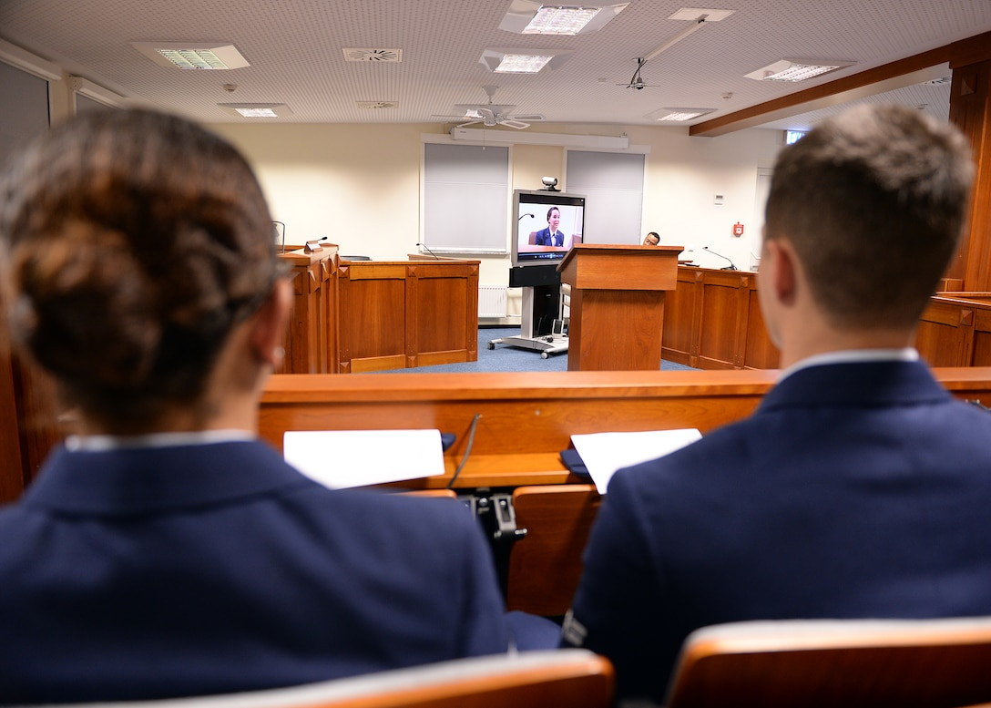 """SPANGDAHLEM AIR BASE, Germany -- Members of a jury panel view a taped statement from a plaintiff at the 52nd Fighter Wing legal office courtroom Oct. 24, 2013, in Spangdahlem's interactive sexual assault prevention campaign, """"Got Consent?"""" The legal office selected jury panel members at random from a pool of new U.S. Air Force Airmen currently enrolled in or recently graduated from the base's initial military familiarization class. (U.S. Air Force photo by Staff Sgt. Daryl Knee/Released)"""
