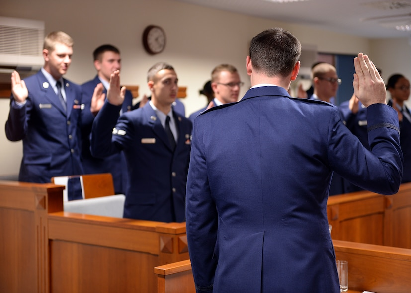 "SPANGDAHLEM AIR BASE, Germany -- U.S. Air Force Capt. Samuel Welch, 52nd Fighter Wing Judge Advocate chief of military justice from Fort Worth, Texas, swears in jury panel members Oct. 24, 2013, at the 52nd Fighter Wing legal office courtroom during Spangdahlem's interactive sexual assault prevention campaign, ""Got Consent?"" Most Airmen on the panel completed less than one year of military service. The training provides an opportunity for first-term Airmen to learn about the legal process early in their careers. (U.S. Air Force photo by Staff Sgt. Daryl Knee/Released)"
