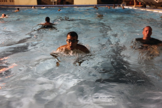 Maj. Rigoberto G. Colon, center, attempts to swim 500-meters in 12 minutes and 30 seconds during a reconnaissance physical assessment test at Camp Hansen Oct. 24. Every Marine in 3rd Reconnaissance Battalion is expected to participate in the RPAT, according to Lt. Col. Eric N. Thompson, the commanding officer of 3rd Recon. Bn., 3rd Marine Division, III Marine Expeditionary Force. Colon is the executive officer for the battalion. (U.S. Marine Corps photo by Lance Cpl. Matthew S. Myers/Released)