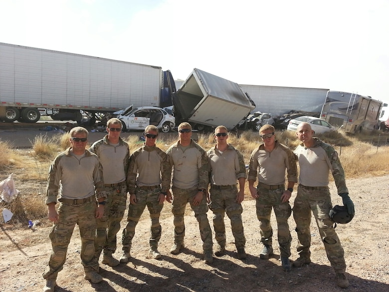 Airmen from the 48th Rescue Squadron at Davis-Monthan Air Force Base, Ariz., stand by a 19 vehicle accident on Interstate 10 near Picacho Peak, Ariz., Oct. 29, 2013. The Airmen extracted five people from vehicles, coordinated four medical helicopter flights, and organized ground transportation for about six injured individuals.