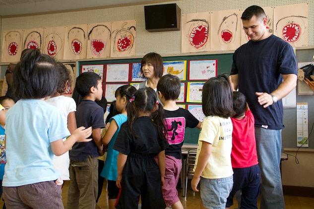 Adam Beyer, right, interacts with kindergarteners during a community relations activity at Kurioso Hoikuen, a local kindergarten, June 28, 2012. The community relations activities are designed to foster a positive relationship between Marine Corps Air Station Iwakuni and the community.