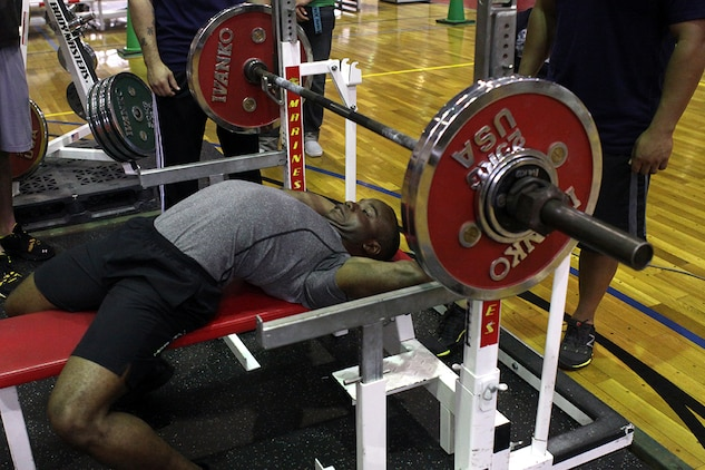 Donyale Young, a 165-pound weight competitor, stretches before he attempts 132.5 kilograms (291.5 pounds) during the 2012 Summer Slam Bench Press Competition at the IronWorks Gym sports courts here June 2. Approximately 28 participants competed, divided into male and female categories comprised of ten weight classes.