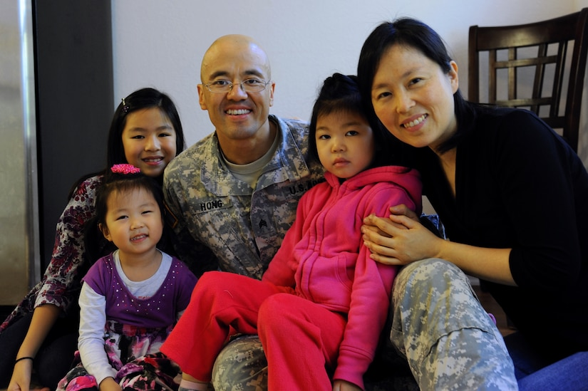 From left, Mary, Grace, David, Sophia and Monica Hong pose for a photo in their home at Fort Eustis, Va., Oct. 21, 2013. Sophia has Dravet Syndrome, a rare form of intractable epilepsy in infants who possess a gene mutation, causing severe seizures and slower development. (U.S. Air Force photo by Airman 1st Class Austin Harvill/Released)